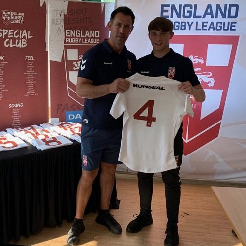 Alex Sutton is presented with his England shirt by former Great Britain international Paul Sculthorpe.