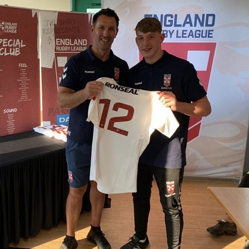 Matty Nicholson is presented with his England shirt by former Great Britain international Paul Sculthorpe.